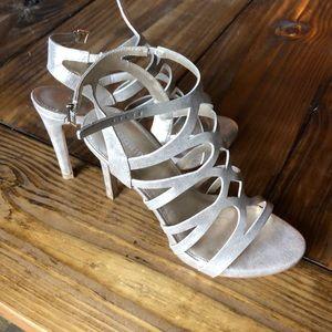 Gold sandal heels.